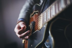 how to become a guitar instructor