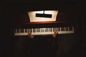a musician playing the piano