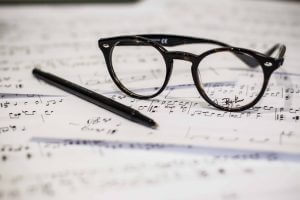 glasses on a music sheet