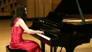 a woman play the piano
