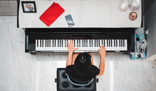 woman sitting at piano practicing