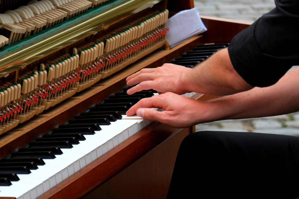 two hands on piano