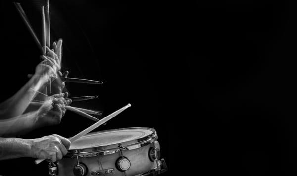 beginner drummer holding sticks