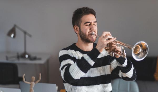 man playing trumpet