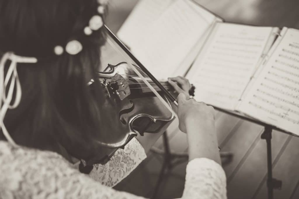 violinist playing with sheet music