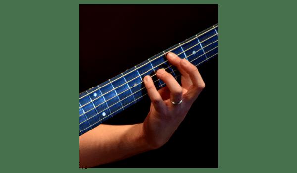 guitar fingers on guitar